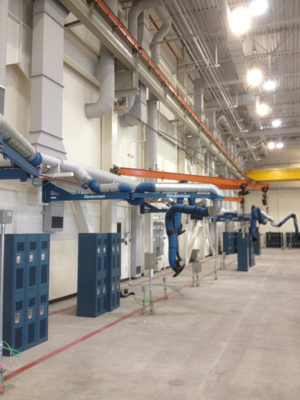 Welding stations with fume arms and extension booms